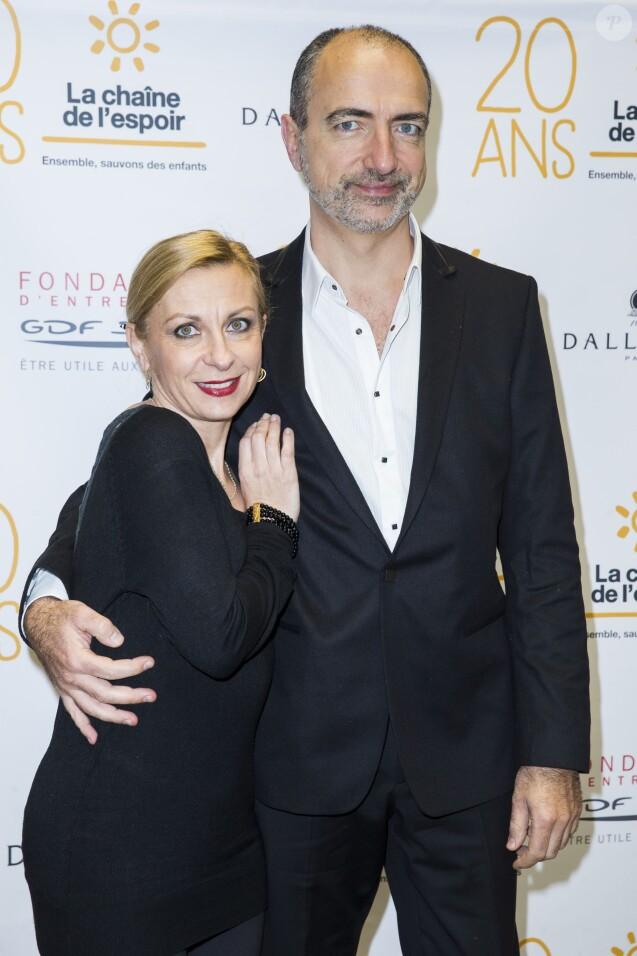 Natalie Dessay et son époux Laurent Naouri - 20 ans de la chaine de l'Espoir à la grande galerie de l'Evolution à Paris le 11 décembre 2014.