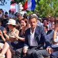 Louis Nègre, le maire de Cagnes-sur-Mer, Maud Fontenoy, Nicolas Sarkozy avec sa femme Carla Bruni-Sarkozy et Eric Ciotti, le président du conseil départemental des Alpes-Maritimes, participent à une rencontre avec des élus et des militants du parti Les Républicains au jardin Albert 1er à Nice le 19 juillet 2015.
