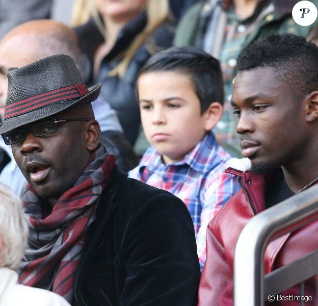 Lilian Thuram, ses fils Kephren et Marcus Thuram - People assistant au match de football de l'équipe du PSG (Paris-Saint Germain) contre l'équipe de Bordeaux au Parc des Princes à Paris le 25 octobre 2014.
