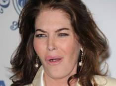 REPORTAGE PHOTOS : Lara Flynn Boyle est une... va-nus-pieds !