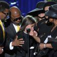 Paris Jackson bien entourée par ses oncles et ses tantes aux obsèques de son père en 2009.