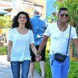 Jermaine Jackson et sa femme Halima Rashid se promenent a Calabasas, le 22 aout 2013.