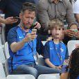 Jean-Luc Lemoine et son fils Gaspard - People au match de la finale de l'Euro 2016 Portugal-France au Stade de France à Saint-Denis le 10 juillet 2016. © Cyril Moreau / Bestimage