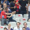 Cristina Cordula et son compagnon Frédéric Cassin, Jean Dujardin - People au match de la finale de l'Euro 2016 Portugal-France au Stade de France à Saint-Denis le 10 juillet 2016. © Cyril Moreau / Bestimage