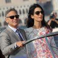 George Clooney et sa femme Amal Alamuddin quittent l'hôtel Aman, où ils ont passé leur nuit de noces à Venise, le 28 septembre 2014