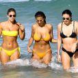 Natasha Oakley, Devin Brugman et Whitney Kaye passent une journée ensoleillée sur la plage de Miami, le 11 juillet 2016.