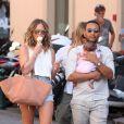 John Legend, Chrissy Teigen et leur fille Luna se promènent à Saint-Tropez. Chrissy porte un débardeur blanc, un short en jean R13, un sa The Row (modèle Market) et des sandales YEEZY (collection SEASON 2). Le 25 juillet 2016.