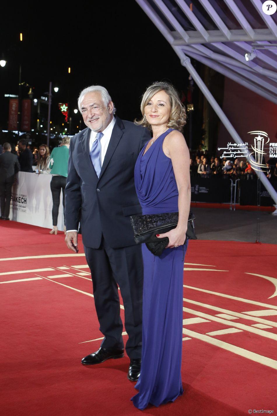 Dominique Strauss,Kahn en paix et radieux avec sa belle pour honorer  Verhoeven