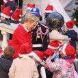 Le prince Albert II et la princesse Charlene de Monaco procédaient le 14 décembre 2016 à la traditionnelle distribution de cadeaux de Noël aux écoliers de la principauté, en présence de leurs enfants le prince Jacques et la princesse Gabriella (laquelle a vite déserté, piquant une colère), et secondés par Louis Ducruet et Camille Gottlieb, enfants de la princesse Stéphanie. © Dominique Jacovides / Bestimage
