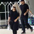 Blac Chyna, enceinte, et son fiancé Rob Kardashian quittent leur hôtel de Miami le 18 mai 2016.