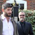 """""""George Michael quitte son domicile avec son petit ami Fadi Fawaz à Londres le 14 mars 2012."""""""