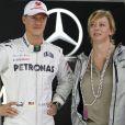 """""""Michael Schumacher et sa manager Sabine Kehm lors du Grand Prix de Formule 1 du Brésil à Sao Paulo le 25 novembre 2012."""""""