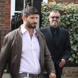 George Michael quitte son domicile avec son petit-ami Fadi Fawaz à Londres le 14 mars 2012.
