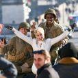 Paris Jackson, (18 ans), pendant un shooting photo pour une publicité Chanel en face de la Tour Eiffel à Paris, France, le 18 janvier 2017. La jeune fille est rayonnante, en tailleur blanc au milieu de plusieurs jeunes hommes habillés en soldats, brandissant dans sa main le drapeau de la France et dans l'autre celui des États-Unis ou en marinière rouge, dans les bras d'un jeunes homme habillé en soldat. Paris Jackson laisse entrevoir des piercings aux tétons sous son chemisier blanc. © Crystal/Bestimage