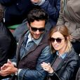 Maxim Nucci (Yodelice) et sa compagne Isabelle Ithurburu dans les tribunes des Internationaux de France de tennis de Roland Garros à Paris. Le 24 mai 2016 © Dominique Jacovides / Bestimage