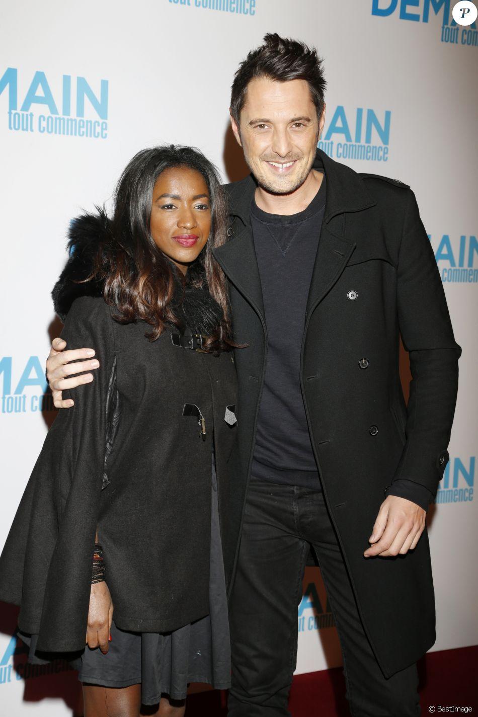 """Vincent Cerutti et sa compagne Hapsatou Sy lors de l'avant-première du film """"Demain tout commence"""" au Grand Rex à Paris le 28 novembre 2016."""