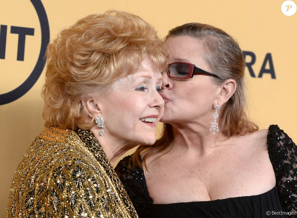 Carrie Fisher et sa mère Debbie Reynolds à la press room des SAG Awards à Los Angeles le 26 janvier 2015.
