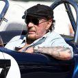 "Johnny Hallyday accompagné de Maxim Nucci (Yodelice), arrive au restaurant ""Soho House"" à Malibu, au volant de son cabriolet AC Cobra, le 9 mars 2017."