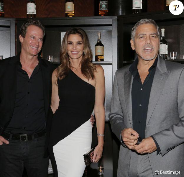 Rande Gerber, sa femme Cindy Crawford et George Clooney - À l'occasion du lancement de son livre, Cindy Crawford a organisé un évènement à Londres, en partenariat avec la marque de téquila de George Clooney à Londres. Le 1er octobre 2015
