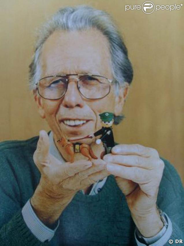 Hans Beck et une figurine avec un chien