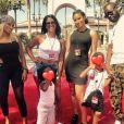Maître Gims publie une photo avec sa femme DemDem et leurs enfants lors d'une visite des studios Universal à Los Angeles. Juillet 2015.