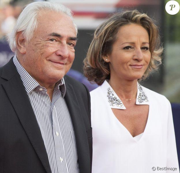 """Dominique Strauss-Kahn et sa compagne Myriam L'Aouffir - Avant-première du film """"Sin City 2"""" lors du 40e festival du cinéma américain de Deauville, le 13 septembre 2014."""