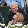 Dominique Strauss-Kahn et sa compagne Myriam L'Aouffir assistent au 8e sacre de Rafael Nadal lors des Internationaux de France a Roland Garros à Paris le 9 juin 2013.