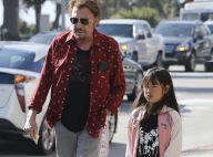 Johnny Hallyday : Papa assoupi avec sa fille Joy, tendre photo souvenir