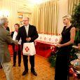 Le prince Albert II de Monaco et la princesse Charlène lors de la traditionnelle distribution des colis de Noël de la Croix-Rouge à Monaco le 17 novembre 2017. © Olivier Huitel / Pool Restreint Monaco / Bestimage