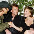 """"""" David Hallyday, Laura Smet et leur père Johnny à l'Amnesia, à Paris, le 1er octobre 2003       """""""
