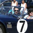 """Johnny Hallyday accompagné de Maxim Nucci (Yodelice), arrive au restaurant """"Soho House"""" à Malibu, au volant de son cabriolet AC Cobra marqué de son chiffre porte-bonheur, le numéro 7. Laeticia Hallyday, toujours en béquilles, les rejoint dans une autre voiture. Malibu, le 9 mars 2017."""