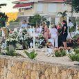 Laeticia Hallyday, ses filles Jade et Joy, Elyette Mamie rock (grand-mère de L. Hallyday), Jean Reno et sa femme Zofia se recueillent sur la tombe de Johnny Hallyday le lendemain de l'enterrement au cimetière marin de Lorient sur l'île Saint-Barthélemy, le 12 décembre 2017.