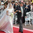 Charlene Wittstock menée par son père Michael le 2 juillet 2011 lors de son mariage avec le prince Albert II de Monaco.