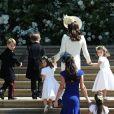 Kate Middleton, duchesse de Cambridge, accompagne la princesse Charlotte de Cambridge, le prince George de Cambridge et les autres flowergirls et pageboys pour la cérémonie de mariage du prince Harry et de Meghan Markle en la chapelle St George au château de Windsor, Royaume Uni, le 19 mai 2018.