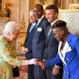 David Beckham, Nicola Adams - La reine Elisabeth II rencontre les invités à la cérémonie des Queen's young leaders awards au palais de Buckingham à Londres le 26 juin 2018.