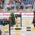 Christian Ahlmann sur Ailina lors de l'épreuve record de saut en hauteur, Six Bar Renault Mobility lors du Longines Paris Eiffel Jumping au Champ de Mars à Paris le 5 juillet 2018