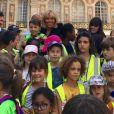 Brigitte Macron a fait visiter le Château de Versailles à des milliers d'enfants Franciliens au cours d'un évènement caritatif organisé par Emerige mécénat le 23 juillet 2018.