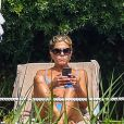 """Exclusif - Jennifer Aniston bronze autour d'une piscine à Portofino en Italie avant le tournage de son prochain film """" 'Murder Mystery!"""" le 22 juillet 2018."""