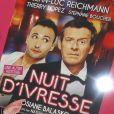 """Jean-Luc Reichmann pose devant l'affiche du film """"Nuit d'ivresse"""" à Paris le 9 janvier 2018"""