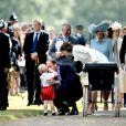 Le prince William et la duchesse Catherine de Cambridge avec leurs enfants le prince George et la princesse Charlotte lors du baptême de cette dernière à Sandringham dans le Norfolk le 5 juillet 2015.