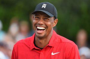 Tiger Woods : Baiser de la victoire avec sa chérie Erica Herman