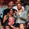 Le prince Harry, duc de Sussex, et Meghan Markle, duchesse de Sussex, enceinte, assistent à la cérémonie de clôture des Invictus Games 2018 à Sydney, le 27 octobre 2018.