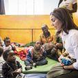 La princesse Mary de Danemark en visite dans le bidonville de Kibera à Nairobi, lors de son voyage au Kenya, avec des membres de la fondation Action, qui aide les enfants, les adolescents et les mères handicapées à une vie meilleure, le 28 novembre 2018.