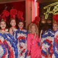 Semi-exclusif - Céline Dion pose avec la revue du Moulin Rouge devant le célèbre cabaret à Paris le 24 janvier 2019.