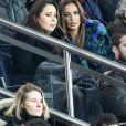 Claudia Tagbo, son compagnon et Malika Ménard (Miss France 2010) dans les tribunes du Parc des Princes lors du match de football de ligue 1 opposant le Paris Saint-Germain (PSG) au Stade rennais FC à Paris, le 27 janvier 2019. Le PSG a gagné 4-1.