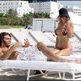 Shauna Sand sur la plage de Miami avec son bel étalon, hier