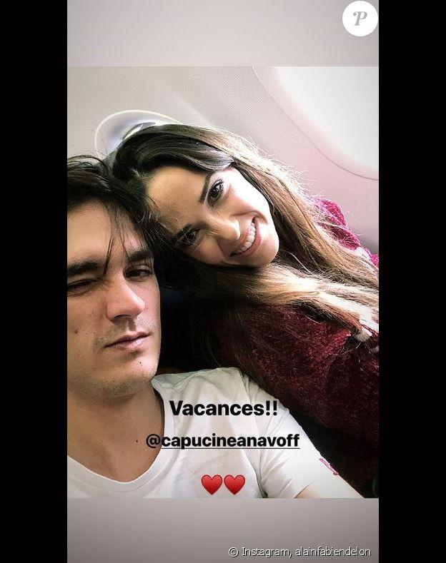 Alain-Fabien Delon et Capucine Anav dans l'avion direction Marrakech. Instagram, février 2019.