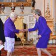 Elizabeth II et Theresa May - La famille royale britannique réunie pour fêter le 50ème anniversaire de l'investiture du prince Charles au palais de Buckingham, le 5 mars 2019.
