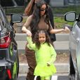 Kim Kardashian et sa fille North West - Exclusif - Les Kardashians arrivent en famille à la messe dominicale à Calabasas. Un cadeau XXL de la part de K. West et de sa femme K. Kardashian est livré à l'église. Le 3 mars 2019  For germany call for price - Please hide children face prior publication Exclusif - K. Kardashian enjoys her Sunday out with her kids at Sunday church service. K. looks casual in a long brown coat, white top, blue jeans, and off white heeled boots. A large gift can be seen being brought into the church which allegedly is a gift from K. West to K. Kardashian, who was also in attendance. 3rd march 201903/03/2019 - Los Angeles