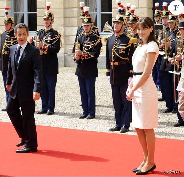 Carla Bruni et Nicolas Sarkozy à Caen lors des cérémonies du 65e anniversaire du débarquement allié en Normandie, le 6 juin 2009
